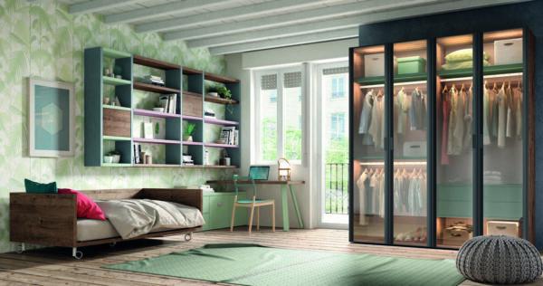 57 – Elegante habitación juvenil que ofrece un plus de movilidad y aprovechamiento del espacio gracias a su cama con ruedas que nos facilitará cualquier tipo de adaptación que necesitemos.